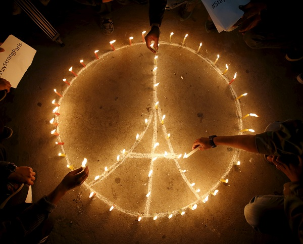 People light candles during a vigil in Kathmandu November 15, 2015, following the deadly attacks in Paris. REUTERS/Navesh Chitrakar
